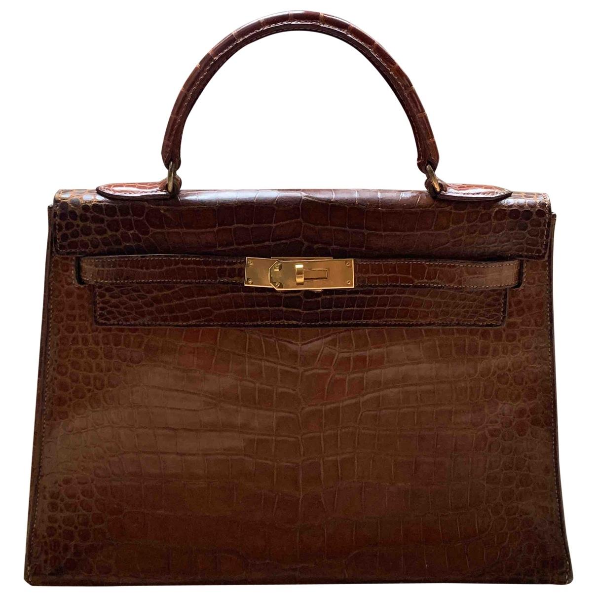 Hermès Kelly 32 Brown Crocodile handbag for Women \N