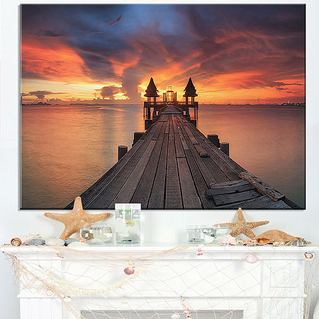 Designart Glowing Sky And Long Wooden Bridge Canvas Art, One Size , Orange