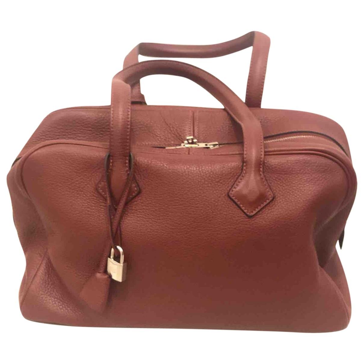 Hermès Victoria Red Leather handbag for Women \N
