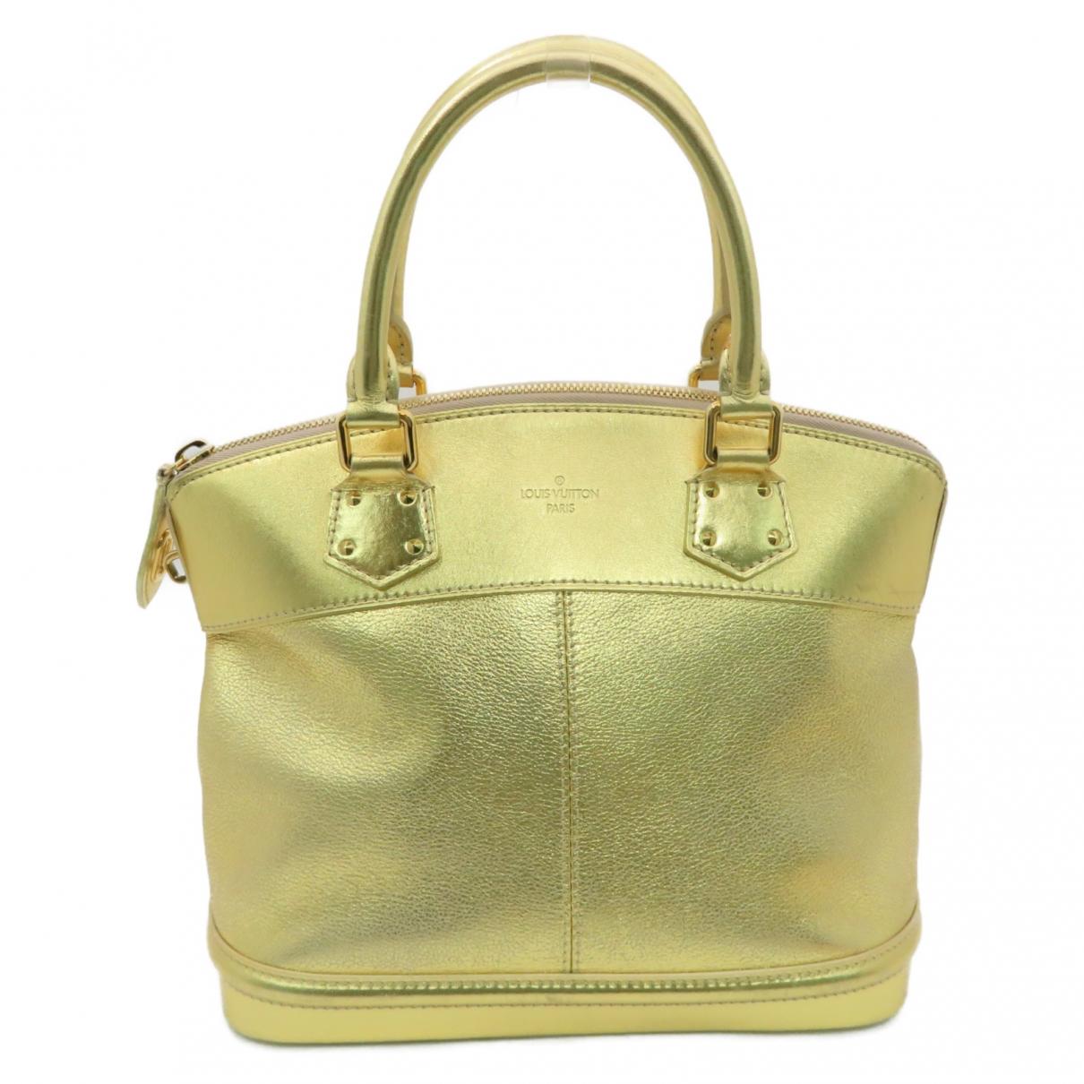 Louis Vuitton Lockit Gold Leather handbag for Women \N