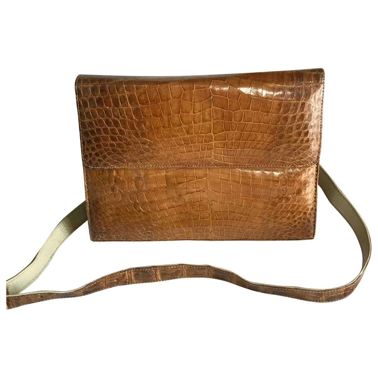Non Signé / Unsigned \N Brown Crocodile handbag for Women \N
