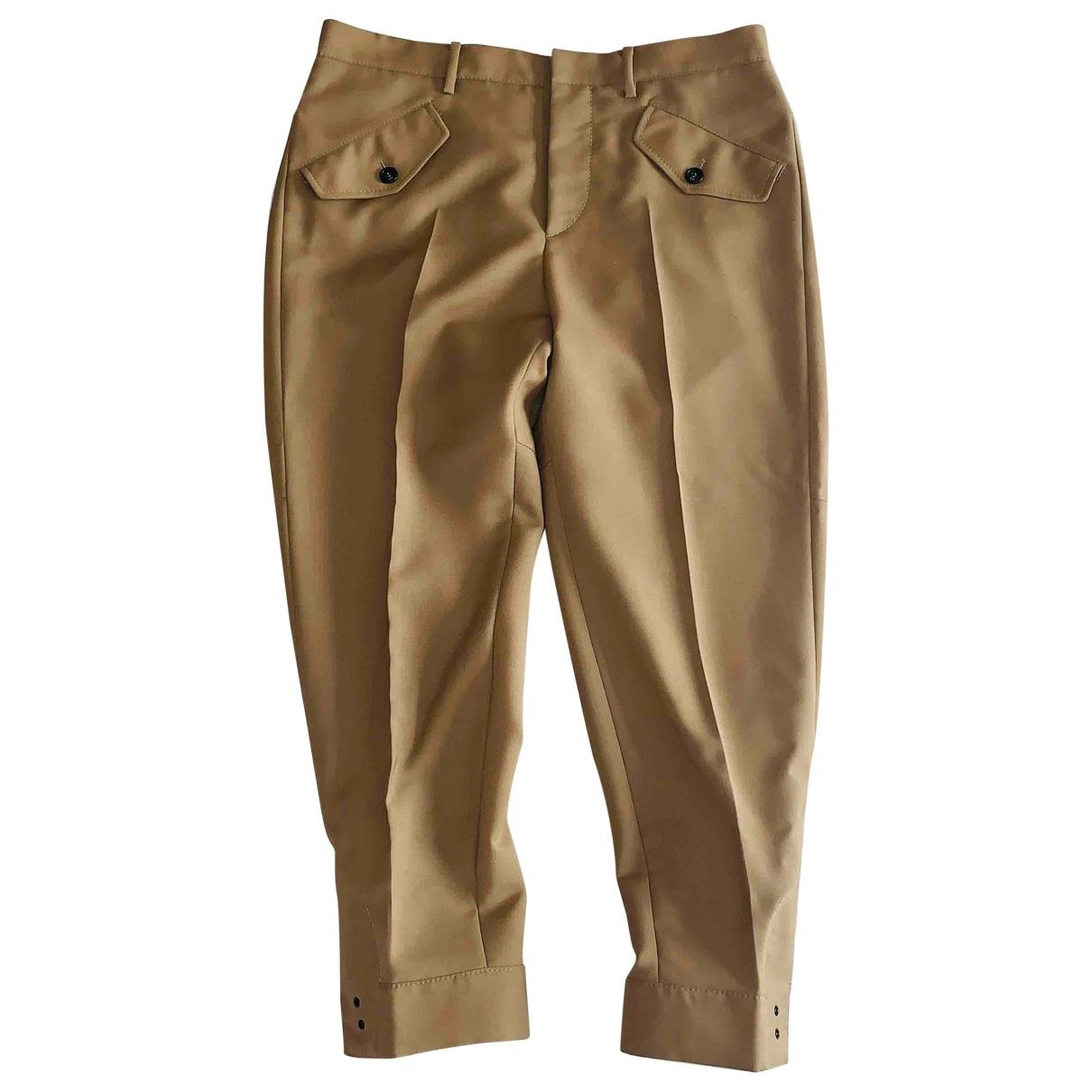 Alessandro Dell'acqua \N Beige Wool Trousers for Women 42 IT