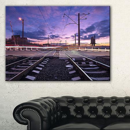Designart Rail Crossing With Blurred Car Lights Canvas Art, One Size , Blue